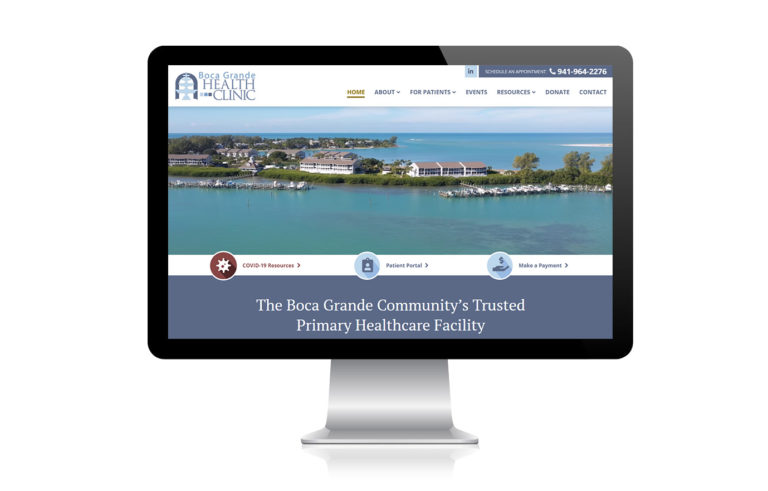 Monitor showing screenshot of the Boca Grande Health Clinic homepage