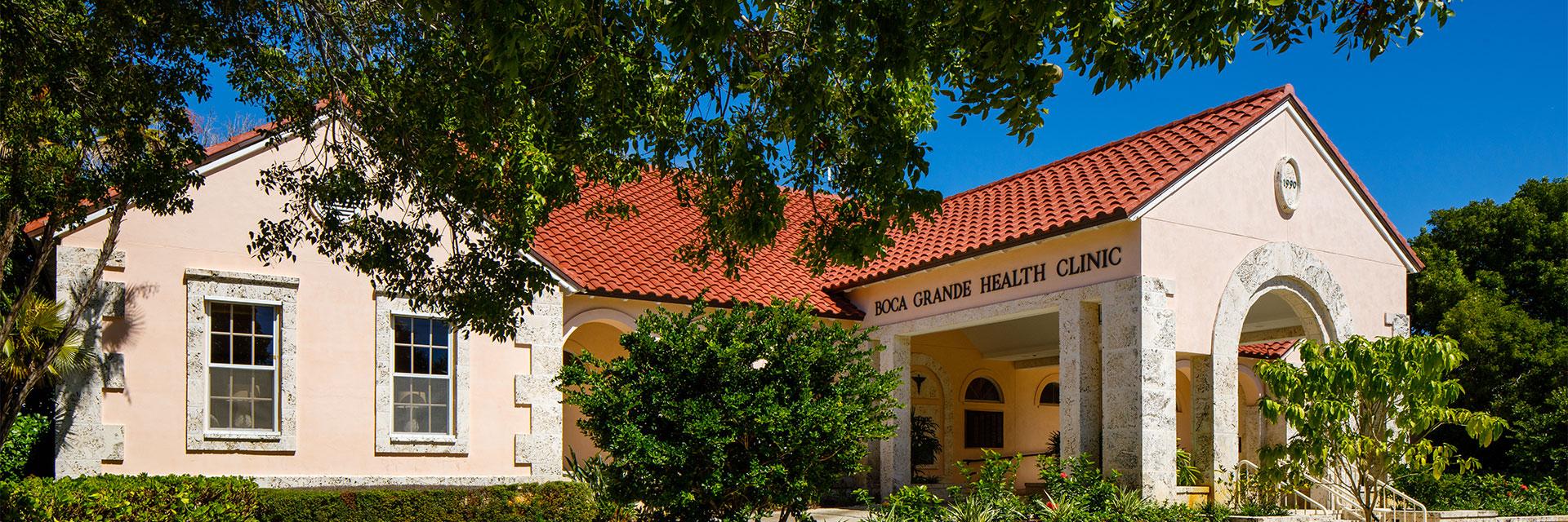 Boca Grande Health Clinic building side view - trees