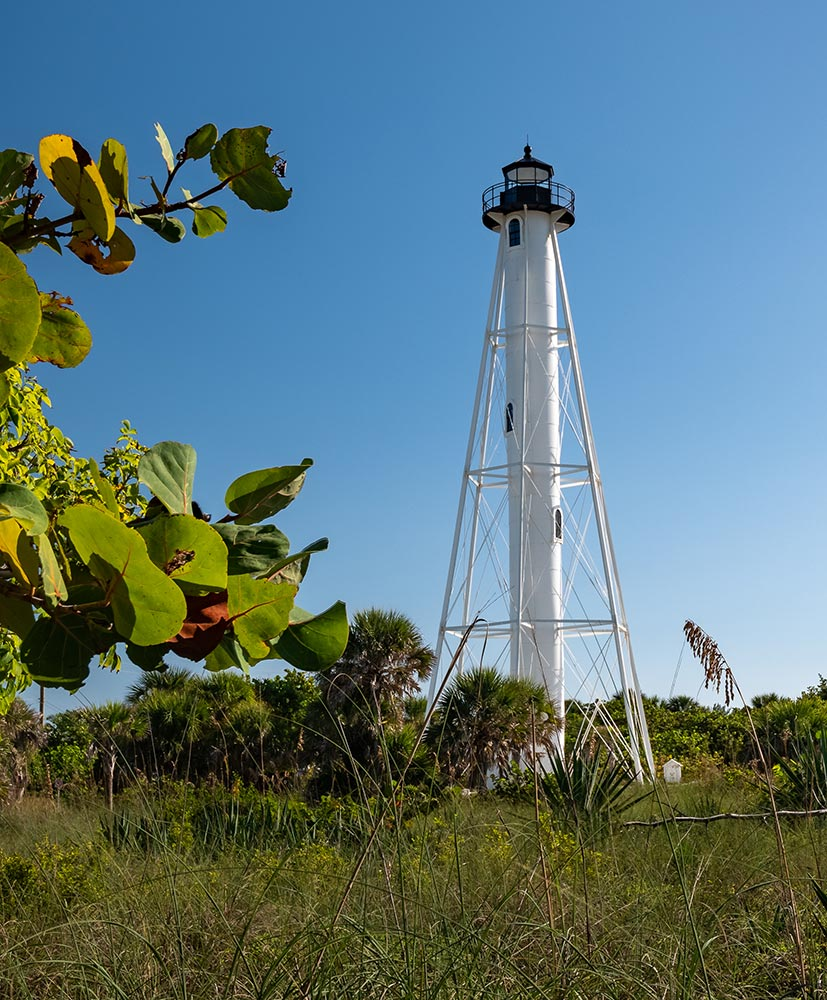historic white lighthouse on the beach in Boca Grande Florida