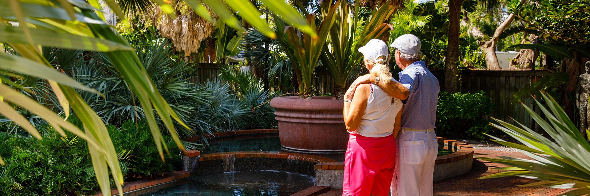 Couple looking at fountain in Boca Grande Florida