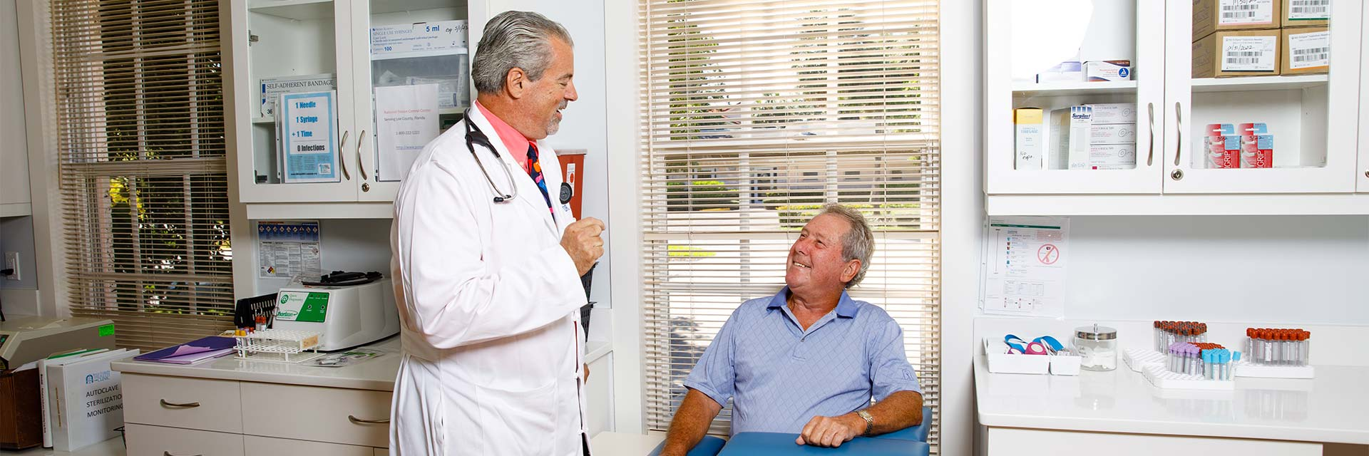 Dr. James with a male patient