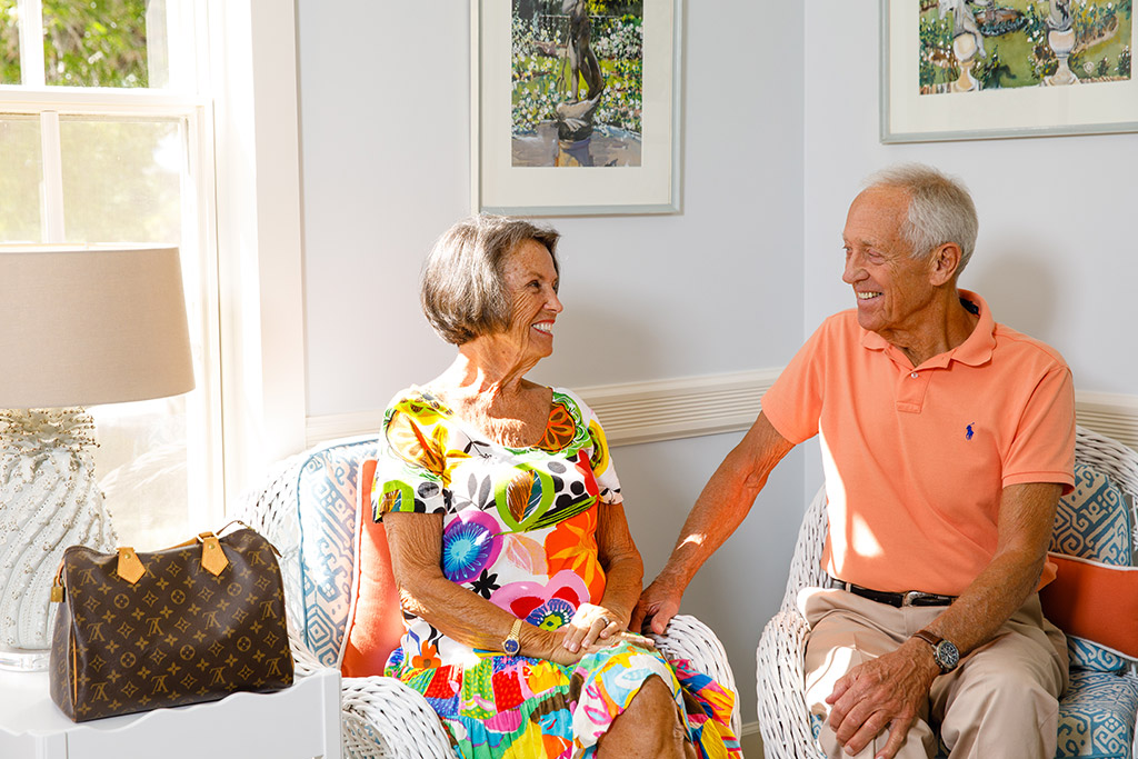 senior couple happily waiting for their appointment